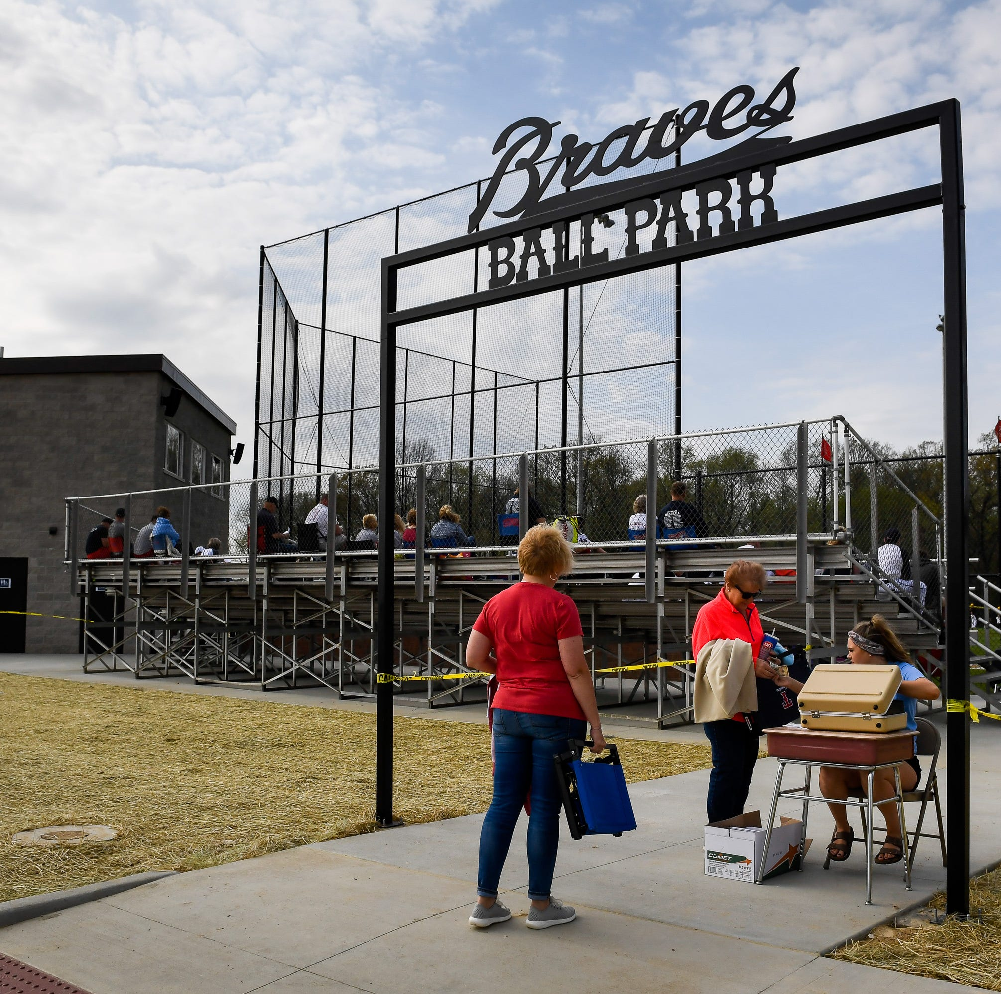 Baseball fans the Braves Ball Park as the Central Bears play the Tecumseh Braves at their new field in Lynnville Wednesday, April 17, 2019.