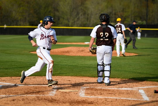 Tecumseh's Dustin Dupont (22) crosses home plate to score in the first inning as the Central Bears play the Tecumseh Braves at their new field in Lynnville Wednesday, April 17, 2019.