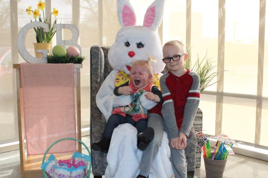 Autumn and Reed Paule had mixed reactions to the Easter Bunny at Geno