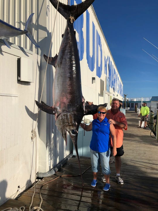 Debbie and Bill Lussier with the monster swordfish they caught off Islamorada