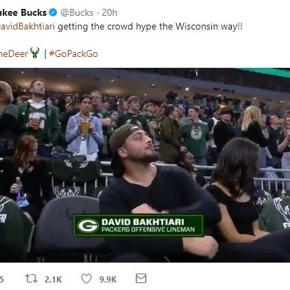 David Bakhtiari whips up Milwaukee Bucks crowd by slamming Spotted Cow for the cameras