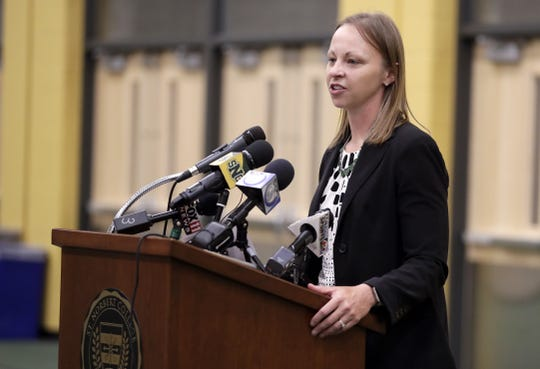 Amanda Leonhard-Perry speaks to media during an introductory news conference Thursday after being named the new St. Norbert College women's basketball coach.