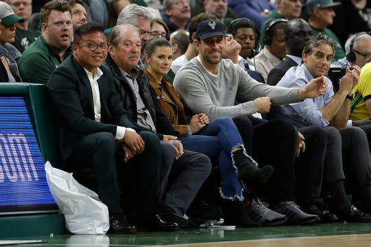 Green Bay Packers' quarterback Aaron Rodgers, right, and Danica Patrick smile during the second half of Game 2 of an NBA basketball first-round playoff series between the Milwaukee Bucks and the Detroit Pistons Wednesday, April 17, 2019, in Milwaukee. The Bucks won 120-99. (AP Photo/Aaron Gash)