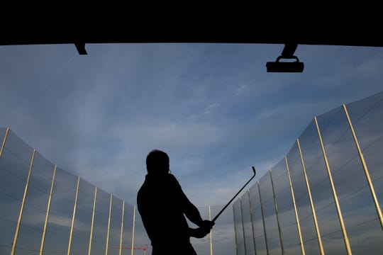Rob Reeves watches to see where his ball lands during a preview day at the new TopGolf location off Pelham Road Wednesday, April 17, 2019.