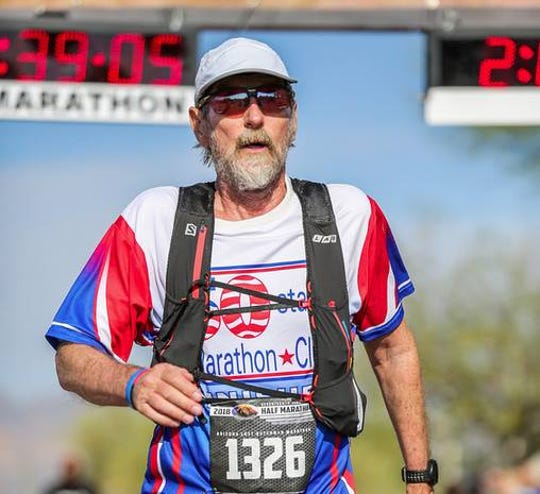 Benji Durden runs in the Lost Dutchman Half Marathon in February of 2018.