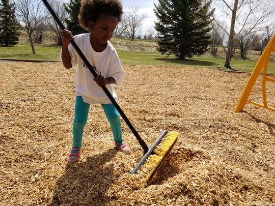 In this 2018 photo, Amara Ochsner assists in the annual Take Pride in our Parks day.