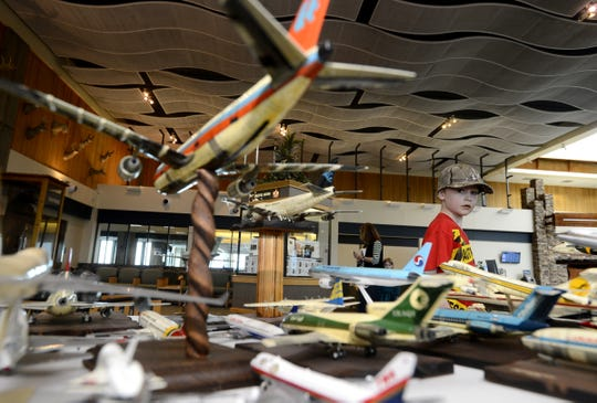 Dawson Utterback,  8, checks out the model airplane collection, put together by the late Bary Poletto, on display at the Great Falls International Airport.