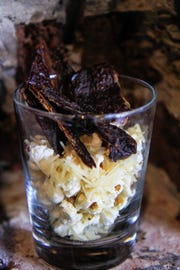 Thing 4: Wagyu Jerky served in a bar glass with popcorn.