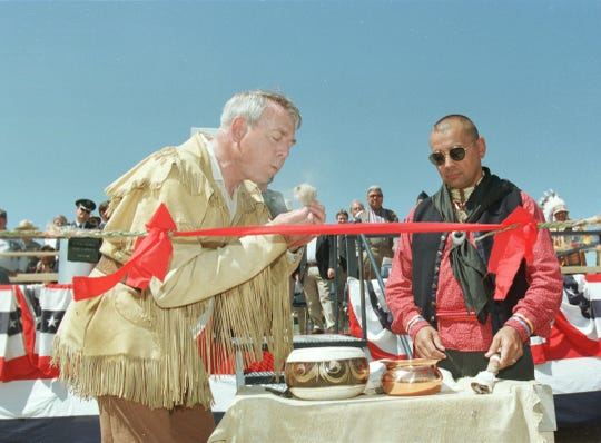 Mike Labriola of the Lewis and Clark Honor Guard, left, prepares to light a smudge stick Saturday, July 4, 1998, at the Interpretive center grand opening.