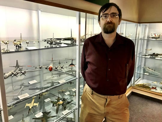 Benjamin Donnelly acts as a tour guide to the model plane collection during an open house at the Malmstrom Museum.