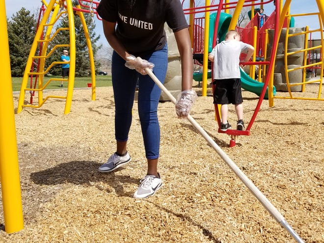 In this 2018 photo, Tranell Blazio helps in the annual Take Pride in Our Parks day.