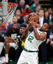 Boston Celtics center Al Horford (42) hauls down a rebound against Indiana Pacers forward Thaddeus Young (21) during the fourth quarter of Game 2 of an NBA basketball first-round playoff series, Wednesday, April 17, 2019, in Boston. The Celtics won 99-91. (AP Photo/Charles Krupa)