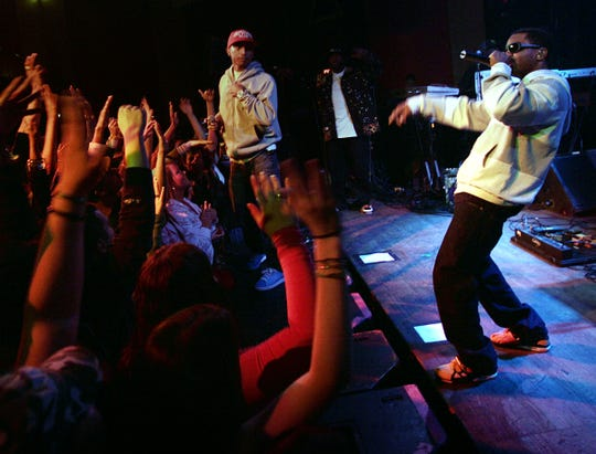N.E.R.D., featuring Pharrell Williams at left, performs at the Vogue in 2008.