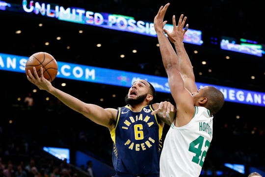 Apr 17, 2019; Boston, MA, USA; Indiana Pacers point guard Cory Joseph (6) takes a shot while guarded by Boston Celtics center Al Horford (42) during the first half in game two of the first round of the 2019 NBA Playoffs at TD Garden. Mandatory Credit: Greg M. Cooper-USA TODAY Sports