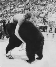 This 1976 photo shows WISH-8 sportscaster Chet Coppock wrestling Victor the Bear at Market Square Arena.
