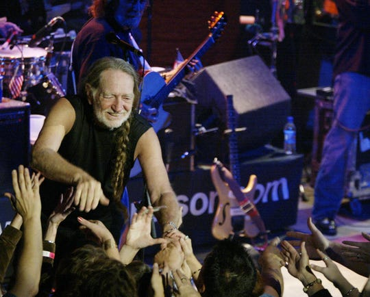 Willie Nelson greets fans after his concert at the Vogue in 2002.