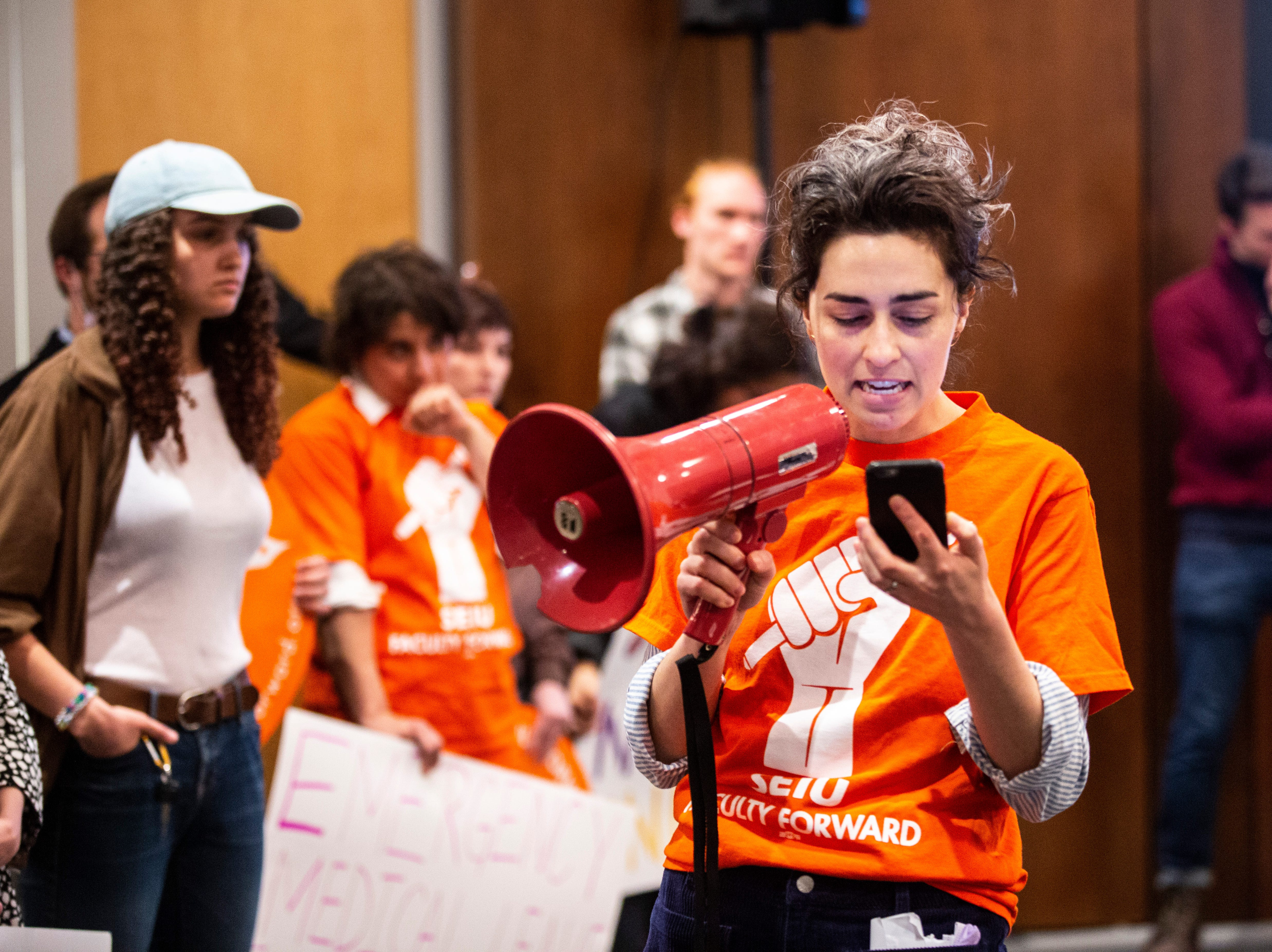 Elizabeth Weiss, a University of Iowa lecturer, reads a statement from the University of Iowa after participating in a protest with members of the Faculty Forward and Service Employees International Union during an Iowa Board of Regents meeting, Thursday, April 18, 2019, in the Levitt Center on the University of Iowa campus in Iowa City, Iowa.
