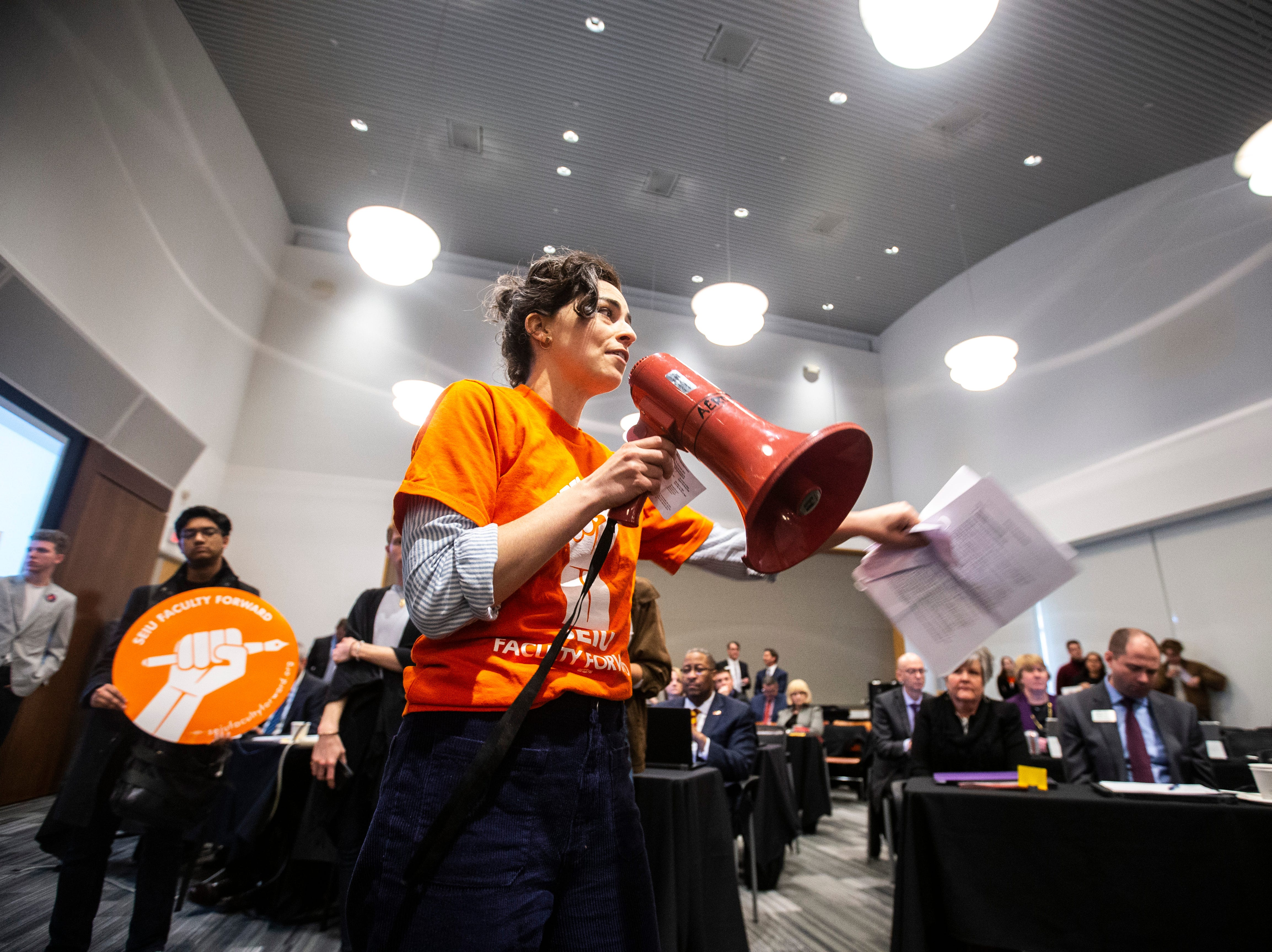 Elizabeth Weiss, a University of Iowa lecturer, leads a chant with members of the Faculty Forward and Service Employees International Union during an Iowa Board of Regents meeting, Thursday, April 18, 2019, in the Levitt Center on the University of Iowa campus in Iowa City, Iowa.