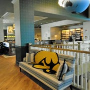 This Tigerhawk couch is one of many Iowa and University of Iowa references throughout the quirky Graduate Hotel here.