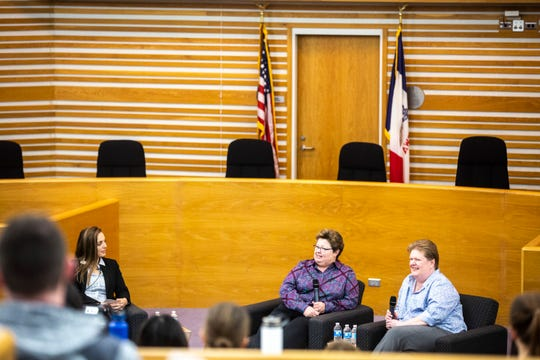 University of Iowa law student Alex Pecora, left, asks Trish and Kate Varnum a question during a panel regarding the Varnum v. Brien Iowa Supreme Court decision, Thursday, April 18, 2019, in the Boyd Law Building on the University of Iowa campus in Iowa City, Iowa.