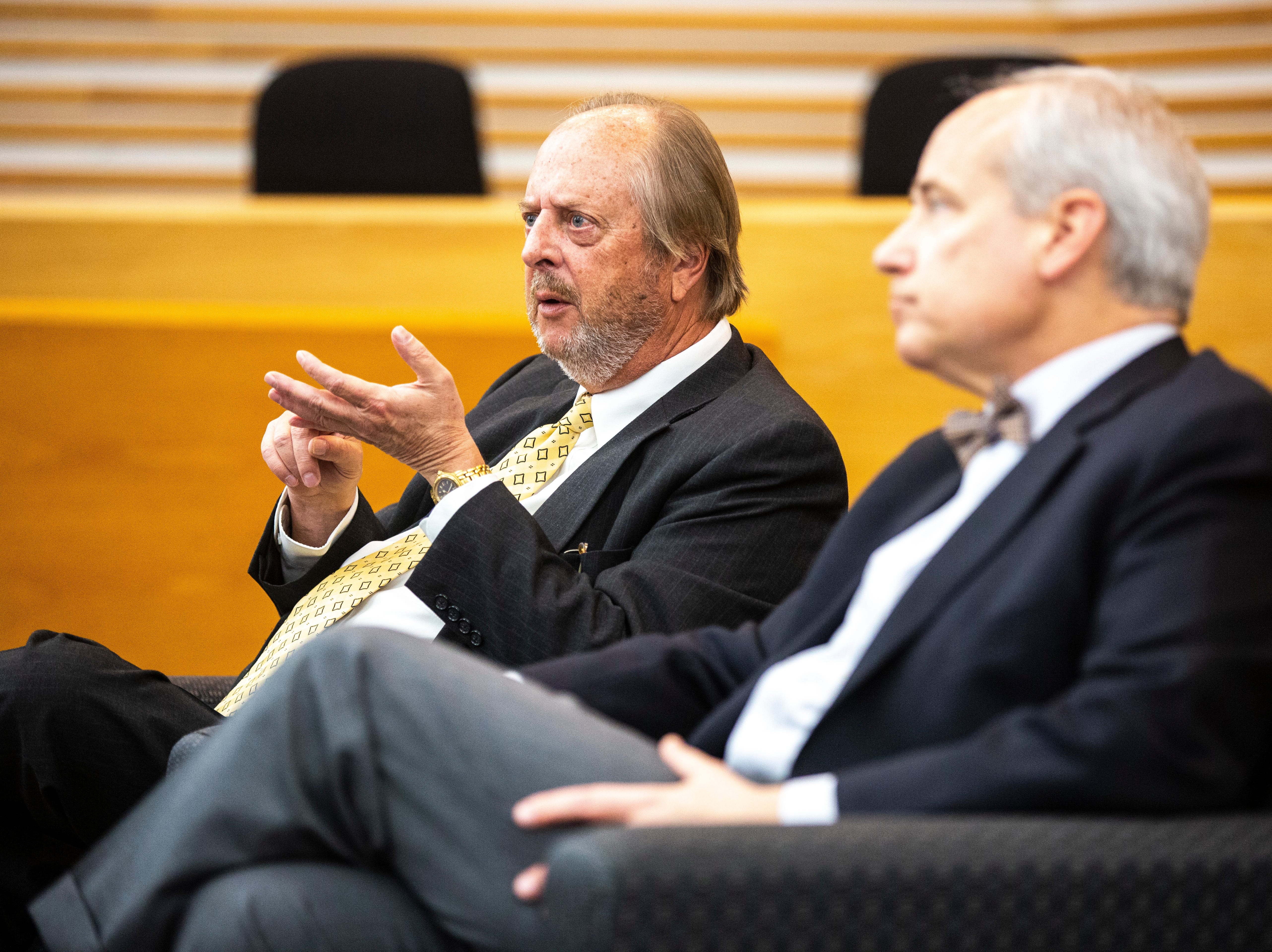 Former Iowa Supreme Court Justice David L. Baker, left, speaks during a panel regarding the Varnum v. Brien Iowa Supreme Court decision with District 5 Judge Robert B. Hanson, Thursday, April 18, 2019, in the Boyd Law Building on the University of Iowa campus in Iowa City, Iowa.
