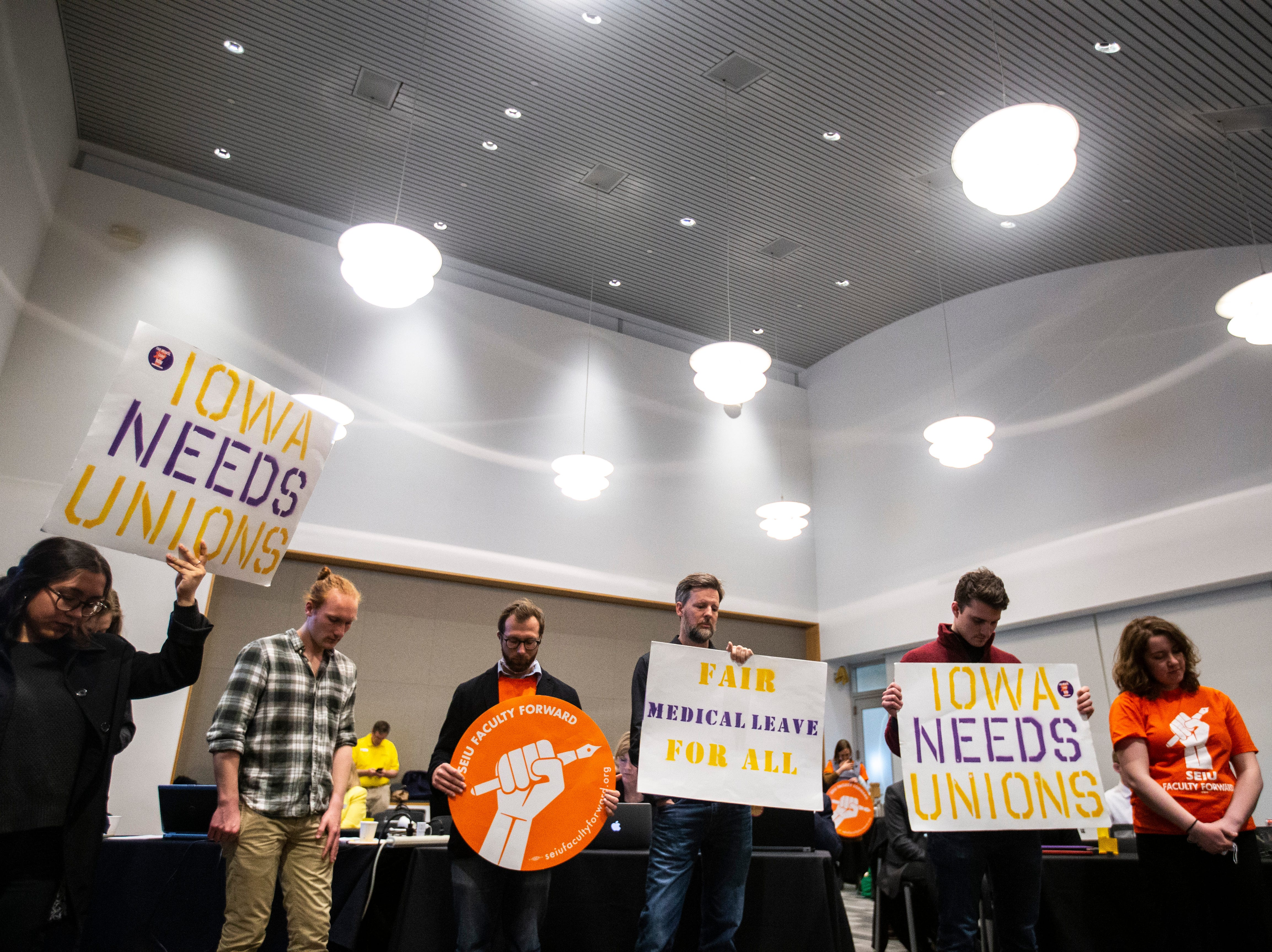 Members of the Faculty Forward and Service Employees International Union protest during an Iowa Board of Regents meeting, Thursday, April 18, 2019, in the Levitt Center on the University of Iowa campus in Iowa City, Iowa.