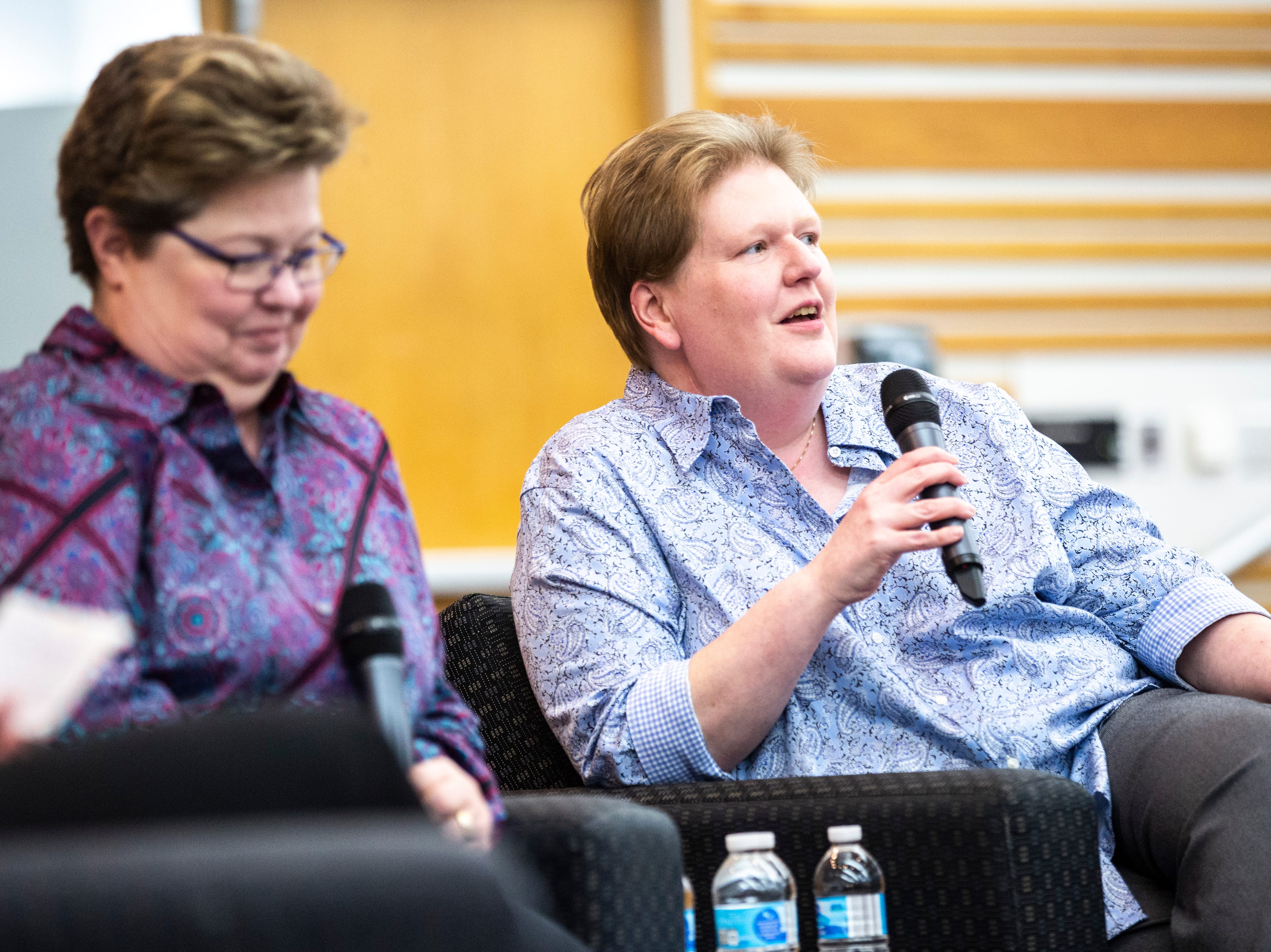 Kate Varnum, right, speaks during a panel regarding the Varnum v. Brien Iowa Supreme Court decision with her wife Trish at left, Thursday, April 18, 2019, in the Boyd Law Building on the University of Iowa campus in Iowa City, Iowa.