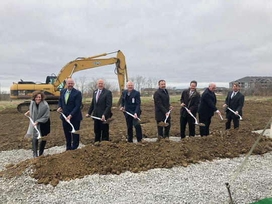 City of Coralville, Mercy Iowa City, Kindred Hospital Rehabilitation officials celebrate the groundbreaking of a new rehabilitation hospital Thursday, April 18, 2019.