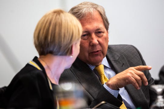 University of Iowa President J. Bruce Harreld, right, speaks with Interim Provost Sue Curry during an Iowa Board of Regents meeting, Thursday, April 18, 2019, in the Levitt Center on the University of Iowa campus in Iowa City, Iowa.