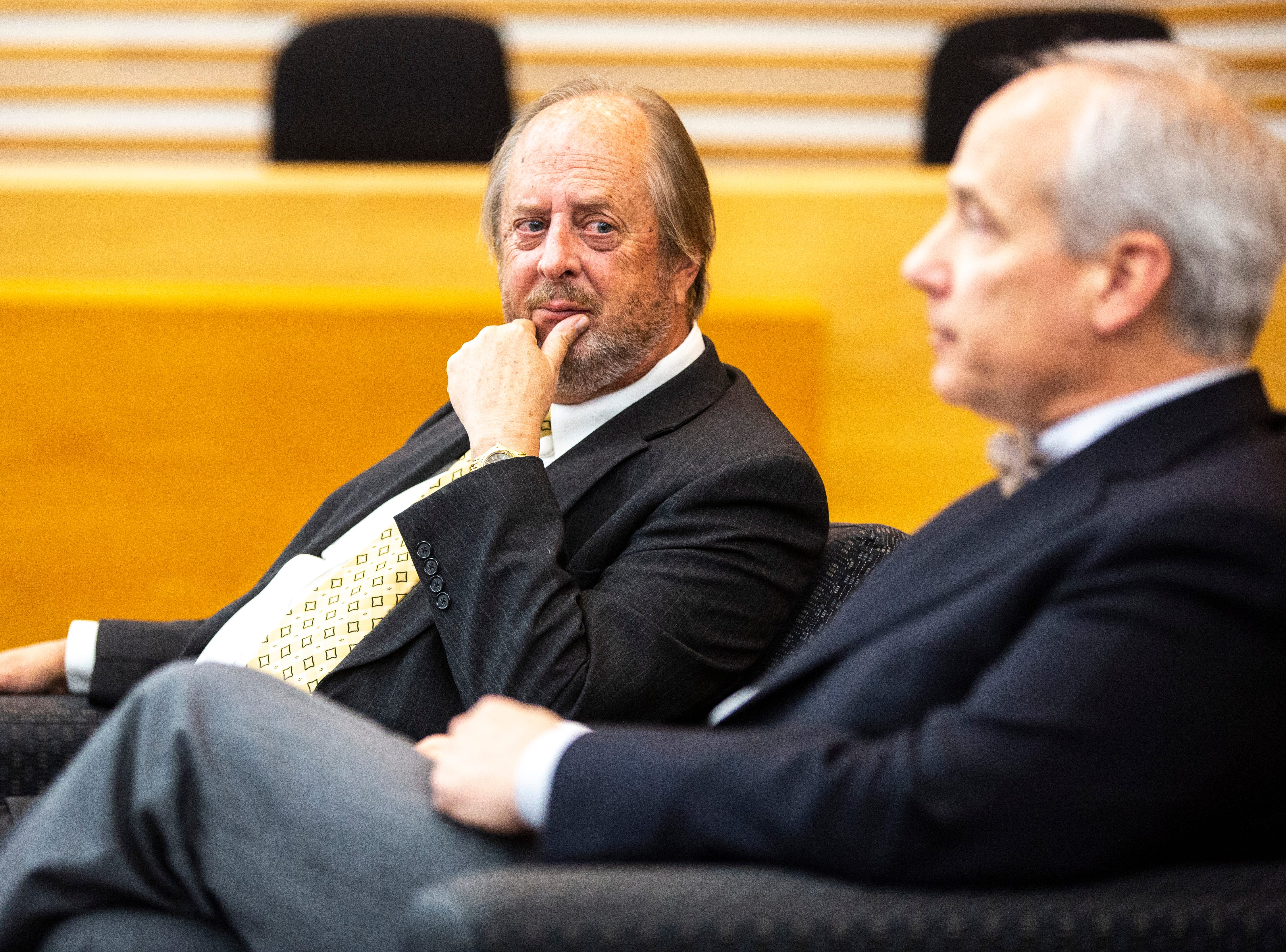 Former Iowa Supreme Court Justice David L. Baker, left, listens during a panel regarding the Varnum v. Brien Iowa Supreme Court decision with District 5 Judge Robert B. Hanson, Thursday, April 18, 2019, in the Boyd Law Building on the University of Iowa campus in Iowa City, Iowa.