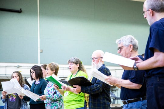 Community members perform during an Oakdale Community Choir practice on Tuesday, April 16, 2019, at Oakdale Prison in Coralville, Iowa.