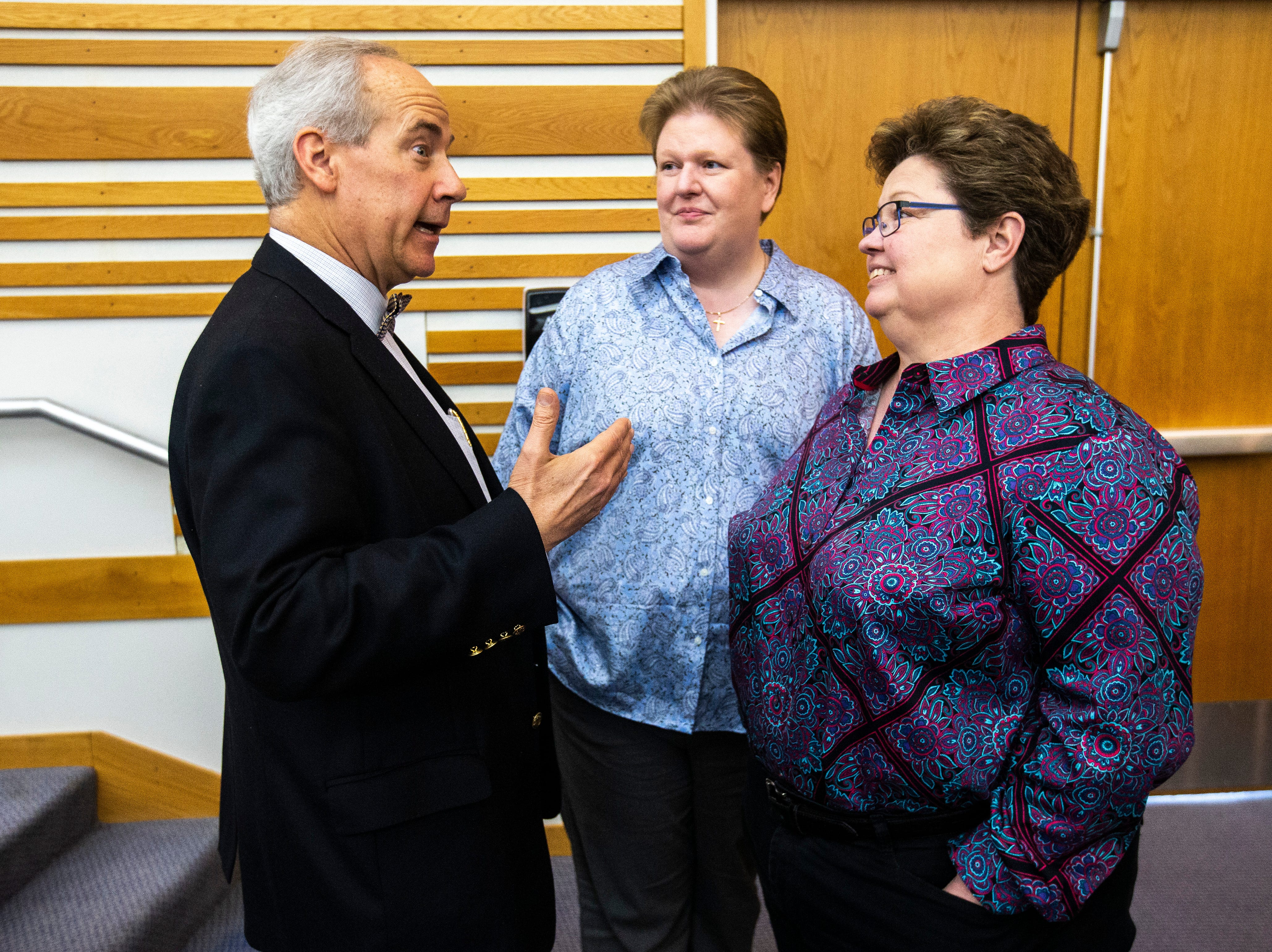 District 5 Judge Robert B. Hanson, left, talks with Kate and Trish Varnum after a panel regarding the Varnum v. Brien Iowa Supreme Court decision, Thursday, April 18, 2019, in the Boyd Law Building on the University of Iowa campus in Iowa City, Iowa.