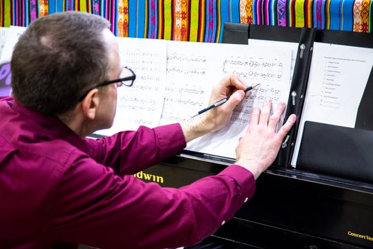 Paul Soderdahl, University of Iowa associate librarian, takes notes on piano during an Oakdale Community Choir practice on Tuesday, April 16, 2019, at Oakdale Prison in Coralville, Iowa.
