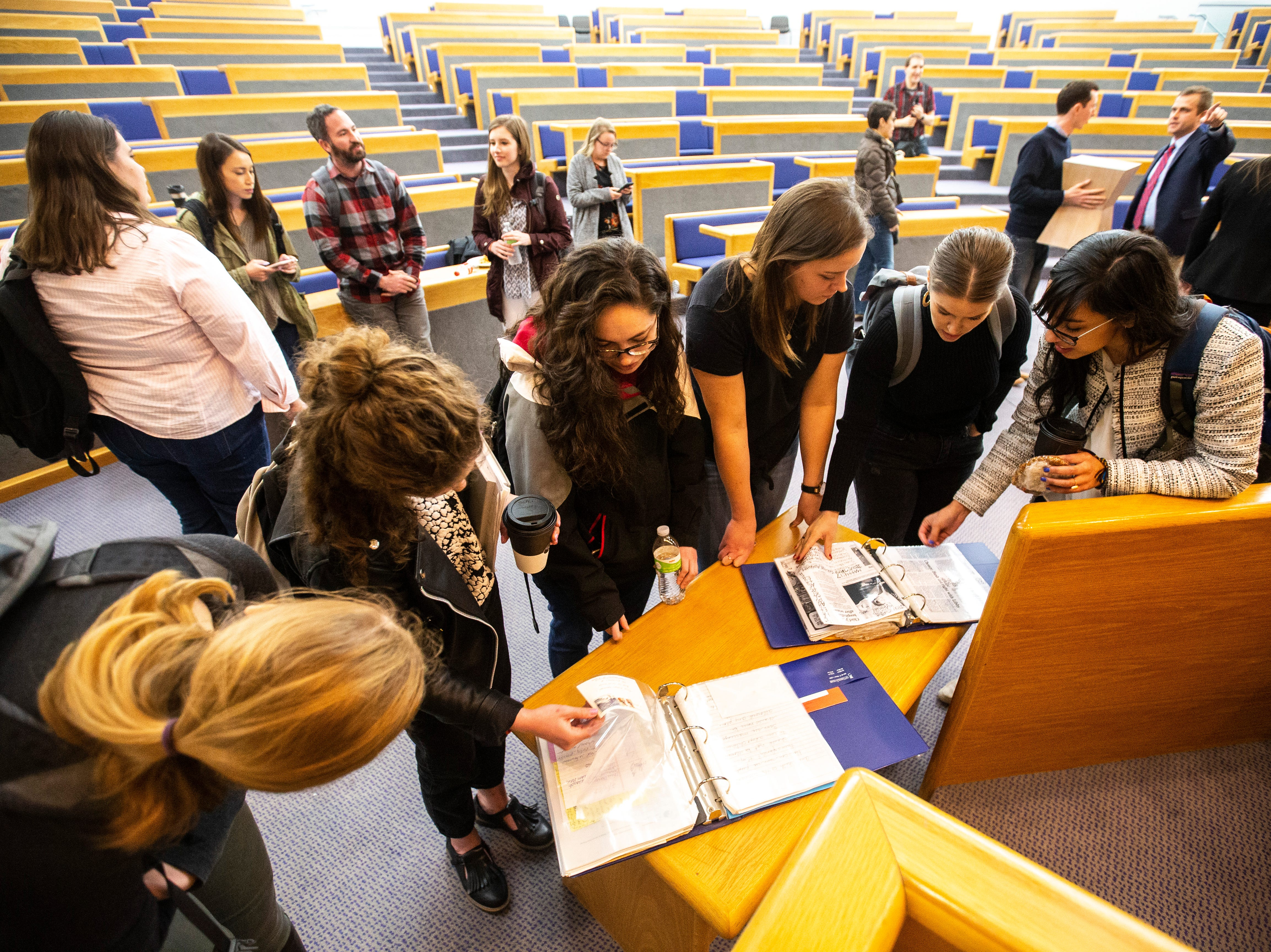 University of Iowa law students look at laminated binders of letters sent to District 5 Judge Robert B. Hanson regarding the Varnum v. Brien Iowa Supreme Court decision after a panel, Thursday, April 18, 2019, in the Boyd Law Building on the University of Iowa campus in Iowa City, Iowa.