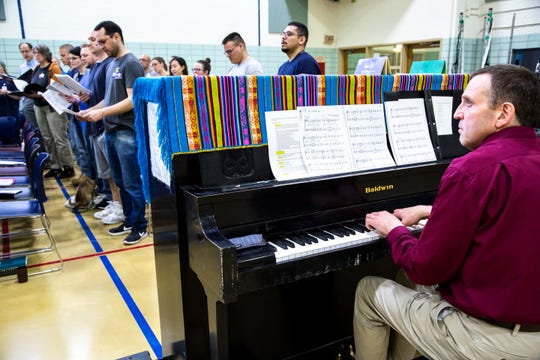 Paul Soderdahl, University of Iowa associate librarian, plays piano during an Oakdale Community Choir practice on Tuesday, April 16, 2019, at Oakdale Prison in Coralville, Iowa.