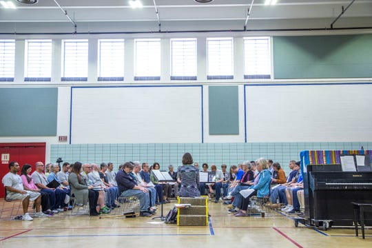 Mary Cohen, an associate professor of music education at the University of Iowa, leads a vocal exercise during an Oakdale Community Choir practice on Tuesday, April 16, 2019, at Oakdale Prison in Coralville, Iowa.