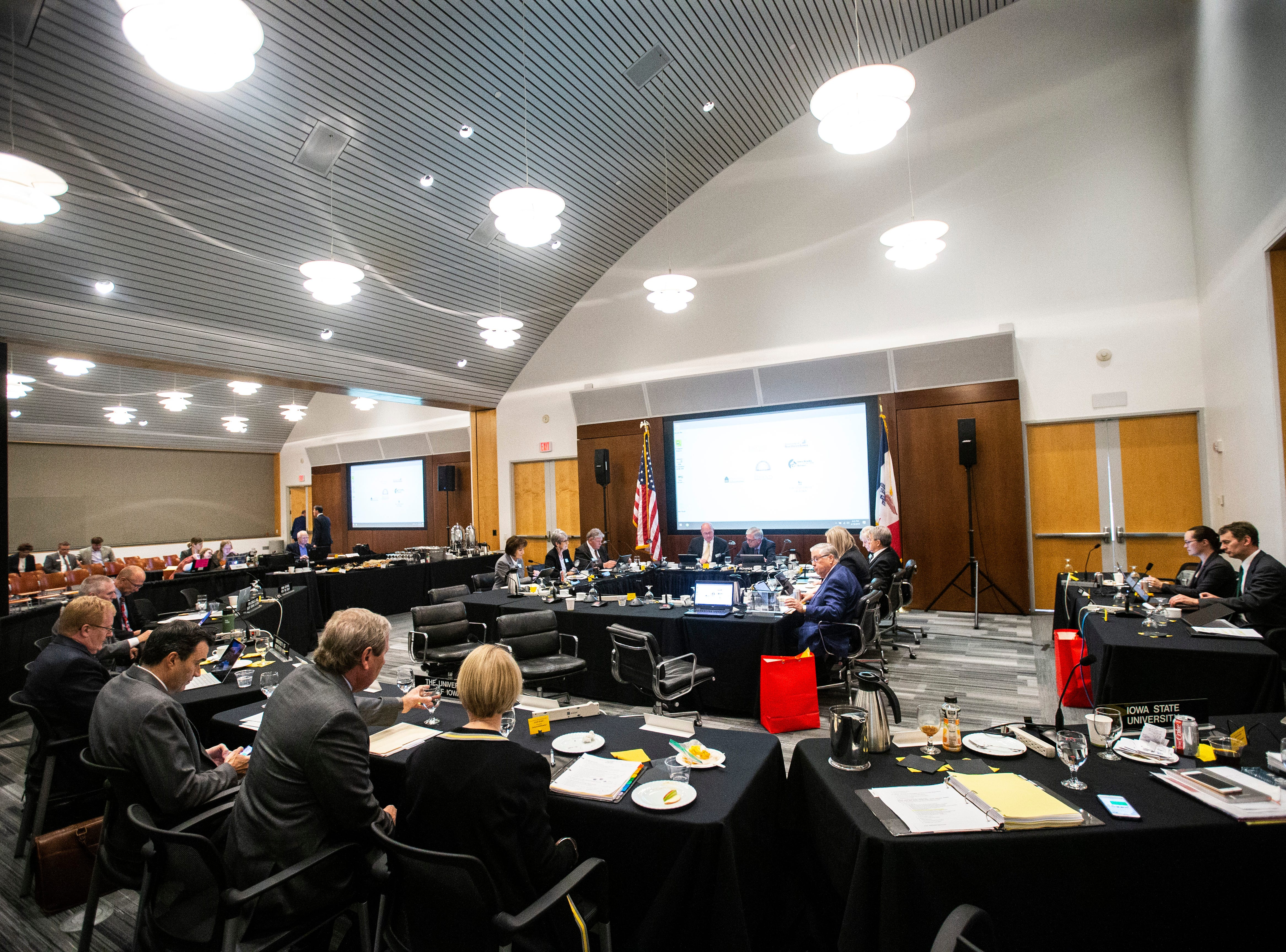 Members find their seats during an Iowa Board of Regents meeting, Thursday, April 18, 2019, in the Levitt Center on the University of Iowa campus in Iowa City, Iowa.