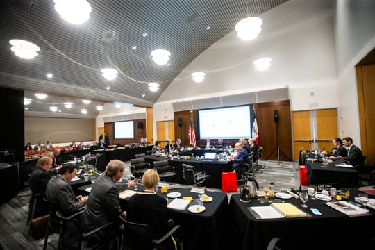 Members find their seats during an Iowa Board of Regents meeting, Thursday, April 18, 2019, in the Levitt Center on the University of Iowa campus in Iowa City, Iowa. Regents initially intended to talk tuition at their April meeting, but delayed the discussion until lawmakers provided more guidance on funding levels.