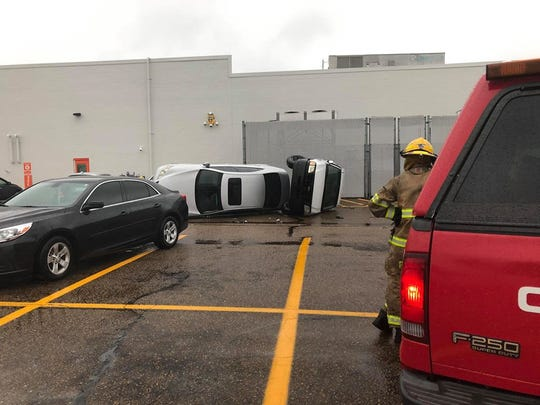Two vehicles flipped over during Thursday afternoon's storms in Clinton.