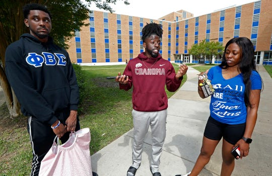 Stefan Young, left, a senior accounting major, and Beronique Martin, a junior chemistry major, right, listen  Thursday, April 18, 2019,  as Larry Sykes, a Jackson State University senior majoring in business administration, stands outside Alexander Hall, and expresses his displeasure with the College Board raising tuition at all of the state's public universities for the fall. Sykes works so he can pay his own tuition. Mississippi's eight public universities plan to raise tuition by an average of 4% next fall, saying state funding increases this year are earmarked for increasing employee costs and they need more money to maintain programs.