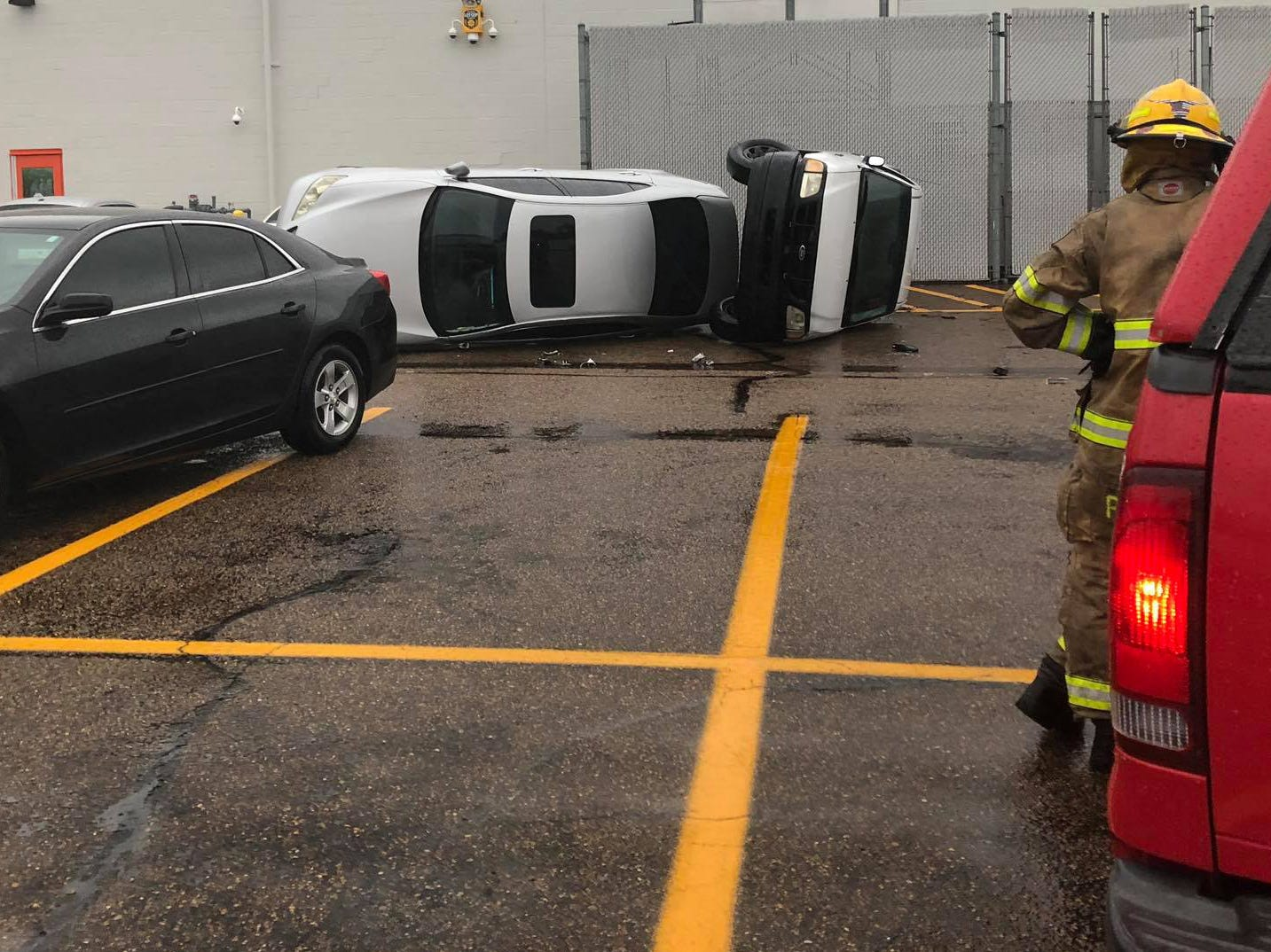A car and truck were flipped in the parking lot of Walmart in Clinton, Miss. during severe weather Thursday afternoon.