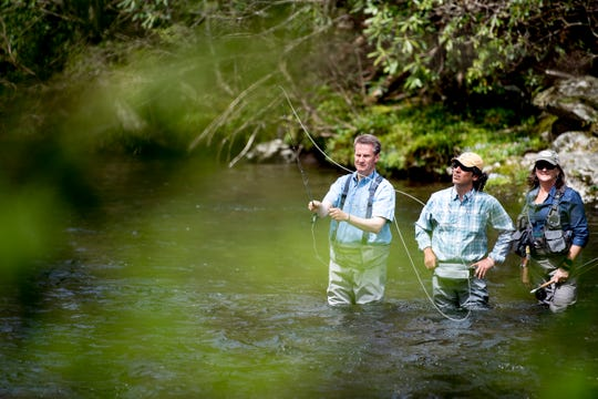 U.S. Rep. Tim Burchett fly-fishes in the Little River with Ian and Charity Rutter, of R&R Fly Fishing, at Metcalf Bottoms Picnic Pavilion in the Great Smoky Mountains on Thursday, April 18, 2019. Though he has not yet signed on as a co-sponsor of a park maintenance backlog bill, Burchett said he likely would.
