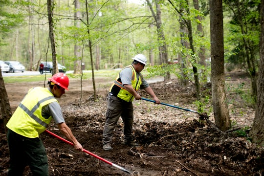 Smoky Mountain maintenance workers Juan Carl, left, and Scott Green clear brush on a construction site at Metcalf Bottoms Picnic Pavilion in the Great Smoky Mountains on Thursday, April 18, 2019.