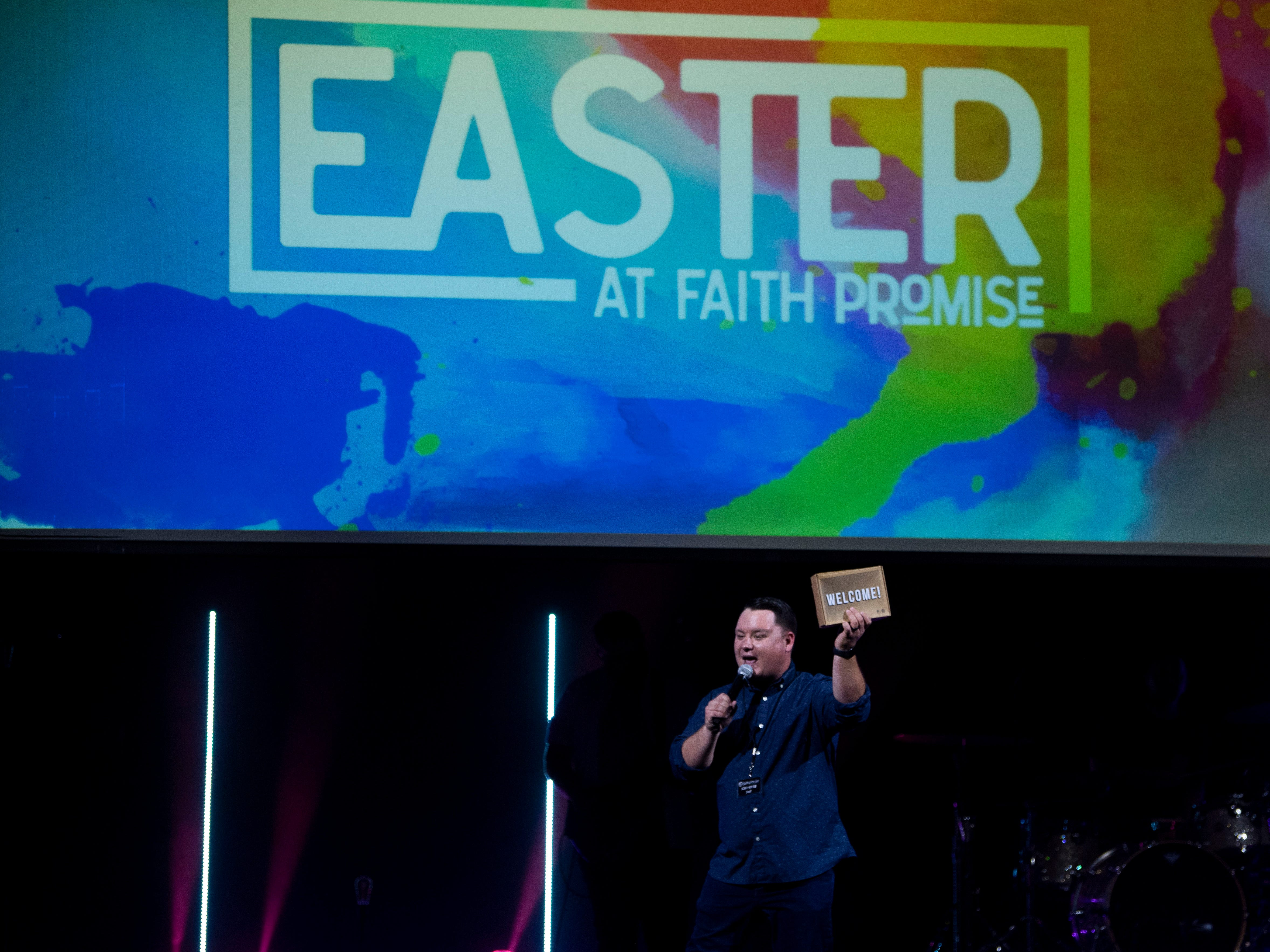 Josh Webb, student pastor at Faith Promise Church's north campus, welcome guests to the church on Wednesday, April 17, 2019.