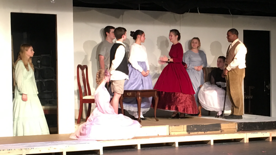 """A large scene from KCT's current production of """"Little Women."""" Shown are Maddy Gracy Payne as Beth, Emma Stark as Amy, Dale Gross as Laurie, Nico Ellerbusch as John Brooke, Ella Campbell as Meg, Brycen Ritchie as Jo, Kennis Van Dyke as Marmee, Alyssa Vogt as Aunt March and Derrick Washington Jr. as Professor Bhaer."""