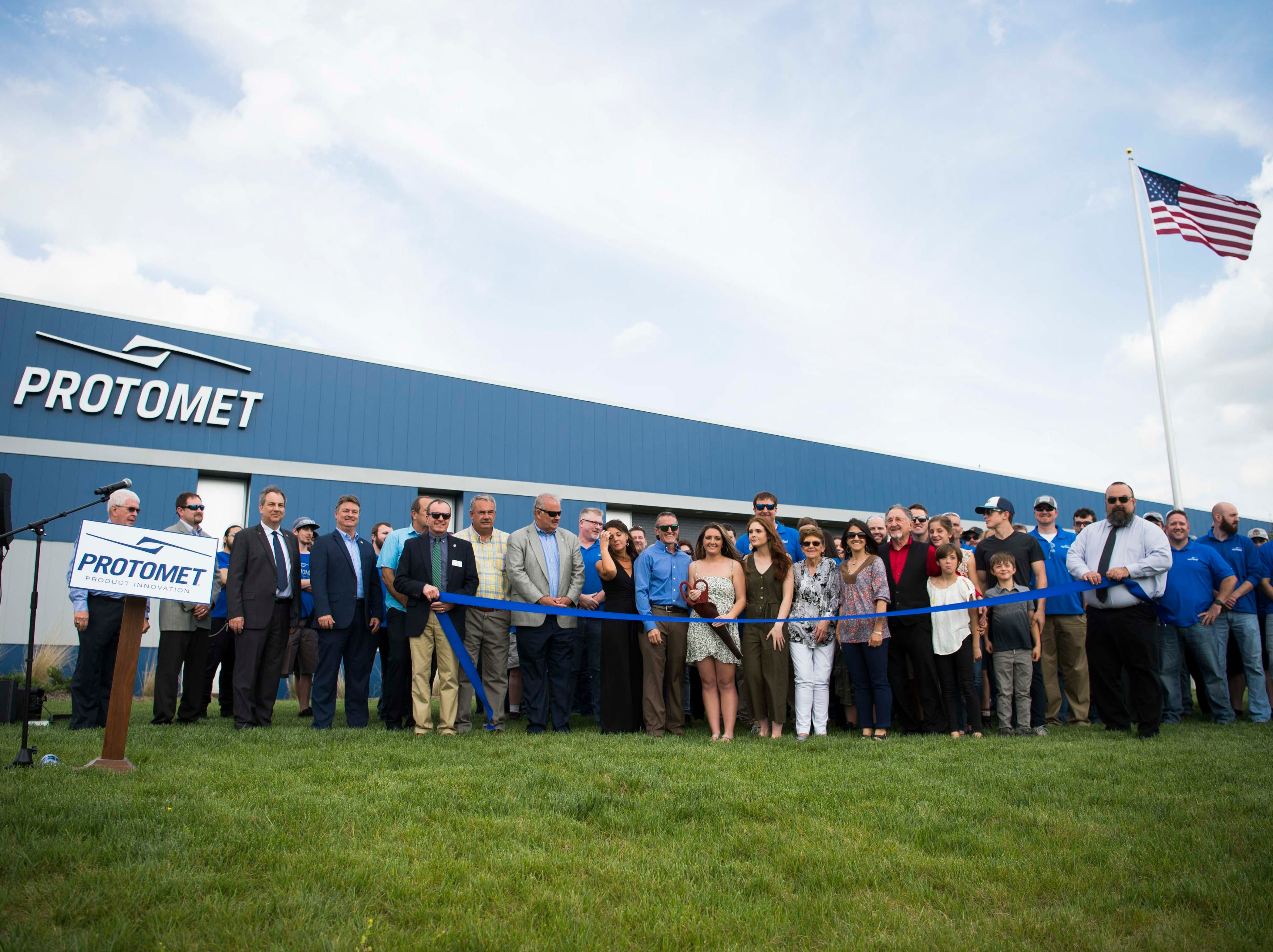 Workers and local officials stand at the ribbon cutting ceremony of Protomet Corporation's $30 million, 244,000 square foot plant in Loudon County Thursday, April 18, 2019. When fully staffed the facility will create 200 new jobs for Loudon County.