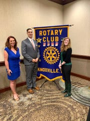"""Natalee Elkins, left, receives the Rotary Club of Knoxville's """"Outstanding Teacher of the Year Award"""" in the middle/high school division at the Crowne Plaza on April 9, 2019. With her are Dr. Jon Rysewyk, assistant superintendent and chief academic officer of Knox County Schools, and Kathryn Lutton, principal of Holston Middle School."""