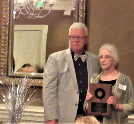 """""""Rear Admiral"""" Joyce Moran received a plaque from Mayor Williams for her many hours as a museum volunteer."""