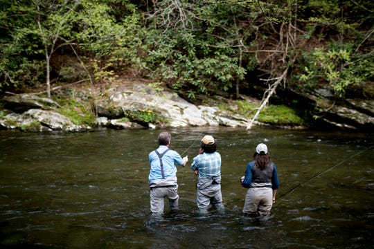 U.S. Rep. Tim Burchett fly fishes in the Little River with Ian and Charity Rutter, of R&R Fly Fishing, at Metcalf Bottoms Picnic Pavilion in the Great Smoky Mountains in Tennessee on Thursday, April 18, 2019. Congressman Burchett was fly fishing in the Smokies to shed light on backlogged projects within the park as well as to support funding for all national parks across the country.