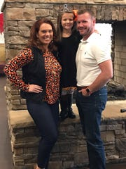 Natalee Elkins with daughter Lillee and husband Harvey, who undoubtedly enjoy hearing Mommy sing around the house! 2019.